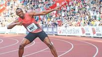 Bolt glides to victory
