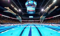 The Latest: Evans, Torres pay visit to swim trials