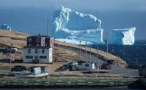 Iceberg in Canada taller than one that sank Titanic draws tourists to Newfoundland town