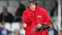 Umpire Bruce Oxenford tries out protective equipment during England v Sri Lanka ODI