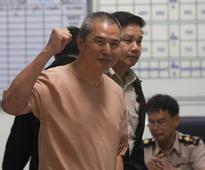 Thai court reduces magazine royal insult sentence