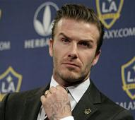Former England football captain David Beckham calls it quits