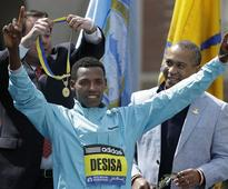 Boston Marathon winner gives championship medal to Boston