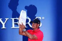 Tiger Woods holds on to win Players as Garcia implodes