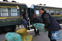 A ride on old-fashioned green train through southwest China mountains