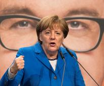 Merkel support hits highest level this year be... German Chancellor Angela Merkel speaks during an elections campaig...