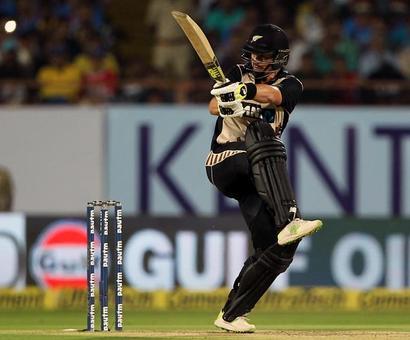 PHOTOS: How Munro and Guptill's new zeal laid India low