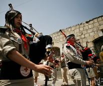 Palestinian Scouts march in celebration of Orthodox Easter