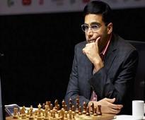 Anand draws with Karjakin, Carlsen beats Adhiban