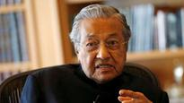 Violence breaks out at former Malaysian PM Mahathir Mohamed's town hall