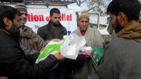 Milli Trust headed by Gilani distributes relief among Handwara fire ...