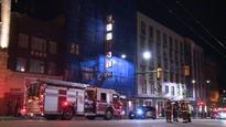 Vancouver firefighters battle blaze in Vancouver's Regent Hotel