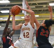 As the NBA shifts toward small ball, height still rules high school hoops