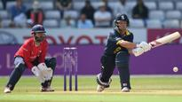 Spin secures win after Trott's century