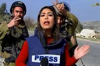 Israeli soldiers mock Palestinian journalist during live broadcast - but she does a brilliant job of ignoring them