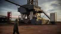 Oil hovers at 2-month low on glut worries