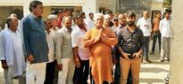 Om Puri meets slain jawan's kin, breaks down