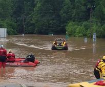 State's worst floods in a century kill 23 in W... Emergency crews take out boats on a flooded I-79 at the Clendenin Exit, afte...