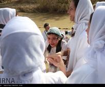 Orthodox Christians baptized in Jordan River