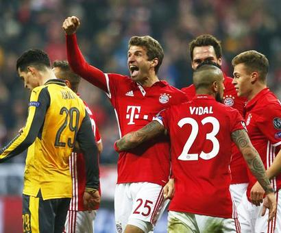 Champions League PIX: Real fight back to beat Napoli 3-1; Bayern rout sorry Arsenal