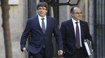 Former Catalan leader Carles Puigdemont faces arrest in Finland