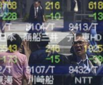 Asian shares slip, Nikkei skids on yen strength