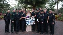 Police officers escort teen to prom