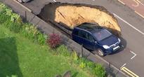 Om-nom-nom! Huge Sinkhole Swallows Car in London