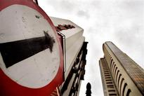 Global cues lift equities, sell-off trims day's gains