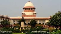 Abusing SC/ST person over phone in public place an offence: Supreme Court