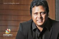 Mani Sharma roped in for Mega hero's movie