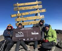 Focus Group summits Kilimanjaro in charity climb