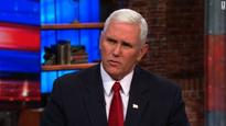 Mike Pence appears at odds with Trump on climate change