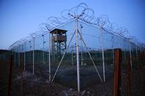 U.S. transfers four Guantanamo inmates in waning hours of Obama tenure