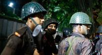 Two officers killed in Bangladesh attack linked to IS, hostages taken