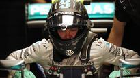 Motor racing: Sebastian Vettel to pip Nico Rosberg, says motor racing great Stirling Moss
