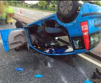 Road Carnage: Trapped driver cut from overturned car during busy day for fire brigade