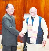 Gogoi meets PM on funds, governor