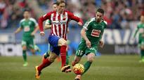 Atletico keep pressure on La Liga leaders Barca