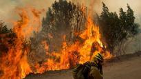 California wildfire burns aggressively across steep terrain