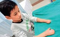 10-year-old Delhi boy able to write again after doctors reconstruct fingers from toes