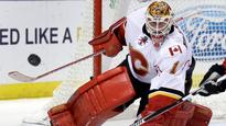 Brian Elliott shines for Flames in return to St. Louis