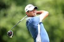 Golf-Day moves one ahead at challenging Firestone
