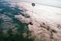 Fr. George, who lost one leg to polio, skydives to help cancer patients