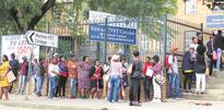 Hundreds wait to enrol