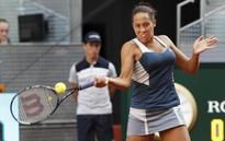 Madison stuns China star Li Na, Serena slogs past Kazakh qualifier