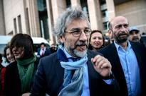Convicted Turkish editor steps down after coup