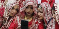 Muslim brides pose for a selfie
