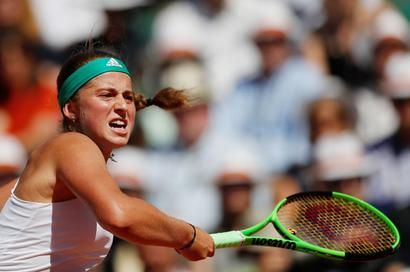 Unseeded Ostapenko stuns Halep to win French Open crown