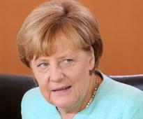 Merkel warns German parties against populist race to the bottom
